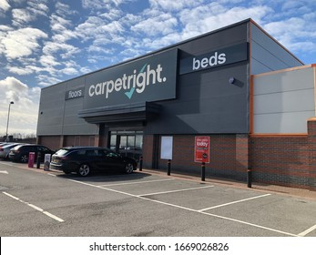 Gateshead, United Kingdom - March 10th 2020: Carpetright Beds and Flooring Superstore in Washington Tyne and Wear UK, set against a beautiful cloud filled blue sky.