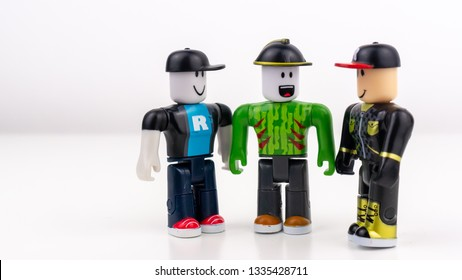 Gateshead, United Kingdom - March 11th 2019: Roblox Toy characters/figures positioned so they look like they are talking to each other, isolated on a white background