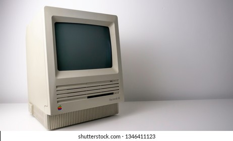 Gateshead, United Kingdom - March 22nd 2019: Apple Macintosh SE Vintage Retro, with rainbow logo, 80's early 90's Personal Computer on White Background sitting from left to right.