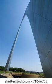 The Gateway Arch monument reaching into the blue sky