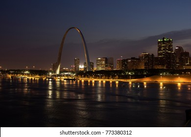 Gateway Arch St Louis Skyline overlooking Mississippi River at night taken from Eads Bridge