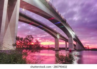 The Gateway Bridge (Sir Leo Hielscher Bridges) at sunset in Brisbane, Queensland, Australia.