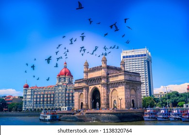 The Gateway of India, birds fly over seen from Mumbai Harbour in Mumbai, India