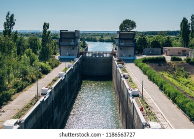 Gateway lock sluice construction on river dam for passing ships and boats.