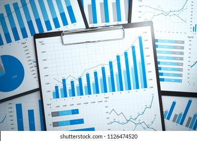 Gathering and analyzing statistical data. Growth strategy planning. Many growth charts and graphs. Pile of business reports.