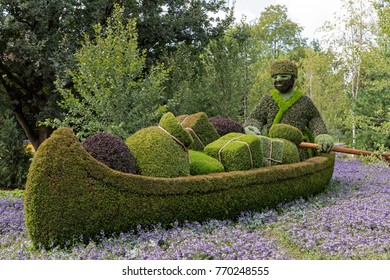 GATINEAU, CANADA – AUGUST 27, 2017: A sculpture of a trader rowing a canoe at the MOSAICANADA 150 exhibition celebrating the 150 anniversary of Canada