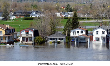 GATINEAU, CANADA - MAY 10 2017:  The severe flooding on Rue Jaques-Cartier on Quebec side of the swollen Ottawa River.  It is one of several areas in North America that has suffered flood conditions.