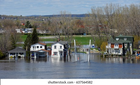 GATINEAU, CANADA - MAY 10, 2017: The severe flooding on Rue Jaques-Cartier on Quebec side of the swollen Ottawa River.  It is one of several areas in North America that has suffered flood conditions.