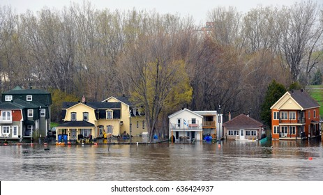 GATINEAU, CANADA - MAY 8, 2017:  The severe flooding on  the Quebec side of the swollen Ottawa River.  Pointe Gatineau is one of several areas in North America that has suffered flood conditions.