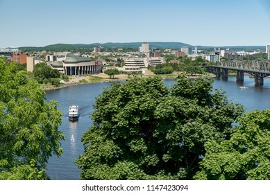 Gatineau, Quebec, Canada - July 12, 2018:  Looking northwest across Ottawa River in summer at Gatineau from Parliament Hill in Ottawa, Ontario.  Alexandra Bridge at right.