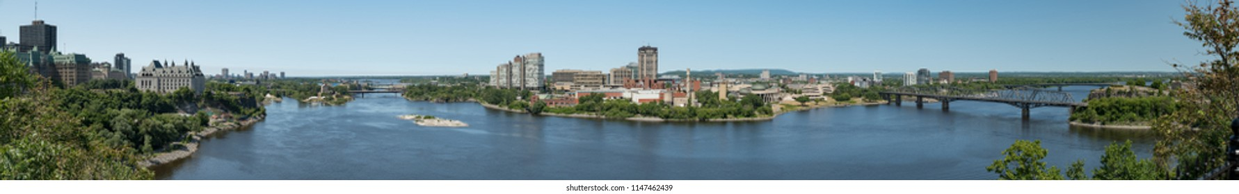 Gatineau, Quebec, Canada - July 12, 2018:  Panoramic view looking across Ottawa River from Parliament Hill in Ottawa, Ontario.  Gatineau in middle, Ottawa at sides, Alexandra Bridge at right.