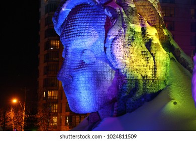 GATINEAU, QUEBEC - FEBRUARY 12, 2018: Mother Earth is one of 24 illuminated snow sculptures at the Mosaivernales winter festival in Jacques-Cartier Park.
