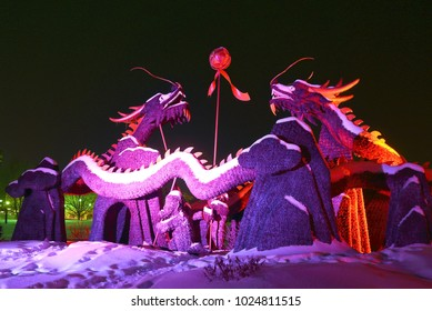 GATINEAU, QUEBEC - FEBRUARY 12, 2018: Blessing of the Good Omen Dragons is one of 24 illuminated snow sculptures at the Mosaivernales winter festival in Jacques-Cartier Park.