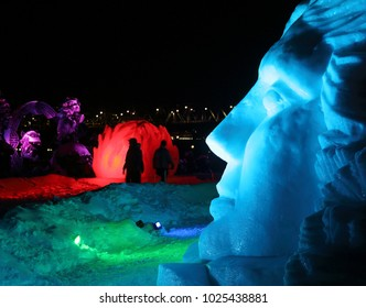 GATINEAU, QUEBEC - FEBRUARY 12, 2018: Illuminated snow sculptures at the Mosaivernales winter festival in Jacques-Cartier Park.