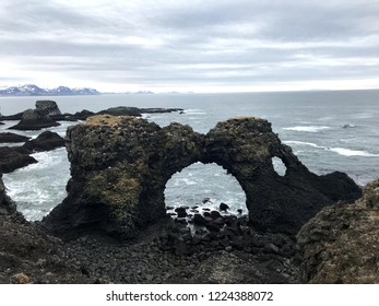 Gatklettur - Arch Rock - is a cliff with a circular arch. Rock Arch shows how distinctive wave action has eroded the rocks into arches and beautiful swirled patterns.