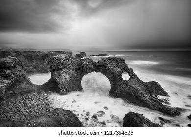 Gatklettur Arch rock, Snæfellsnes Peninsula. Arnarstapi, Iceland. Black and white picture.