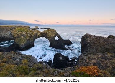 Gatklettur at autumn sunset, an  Arch Rock in west Iceland