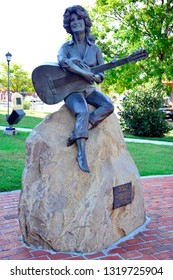 Gatlinburg, Tennessee / USA - August 1, 2016: A statue honoring the American singer, songwriter, actress, and entrepreneur Dolly Parton and her contributions to the region.