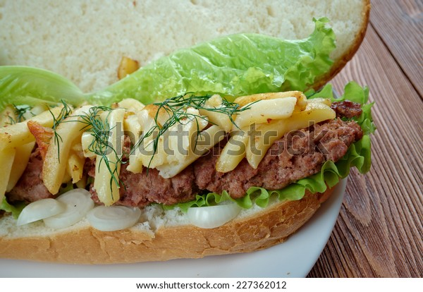 Gatsby  - South African sandwich.Different varieties of Gatsbys include masala steak, chicken, polony, Vienna sausage, calamari, fish, and chargrilled steak.