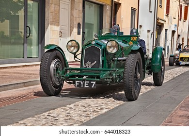 GATTEO, FC, ITALY - MAY 19: driver and co-driver on an old Alfa Romeo 8C 2300 Monza (1933) in historical classic car race Mille Miglia, on May 19, 2017 in Gatteo, FC, Italy
