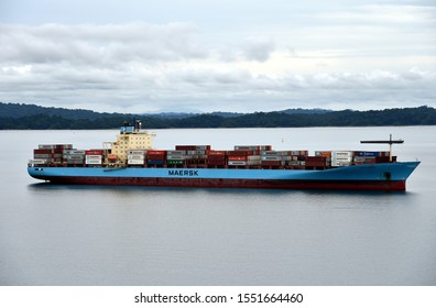 Gatun Lake / Panama - October 17 2019: cargo container ship owned by Maersk Line is transiting through the Panama Canal on the cloudy day.