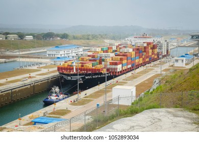 Gatun, Panama - April 6 2017: Ship entering the new Gatun Locks of the Panama Canal being pulled by a tug boat