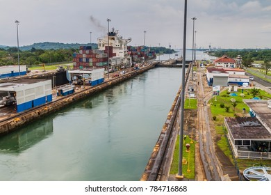 GATUN, PANAMA - MAY 29, 2016: Container ship is  passing through Gatun Locks, part of Panama Canal.