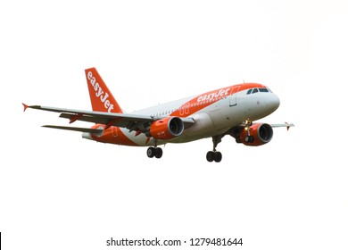 GATWICK AIRPORT, ENGLAND, UK – AUGUST 30 2018: An easyJet Airlines Airbus A319-100 plane comes in to land at London Gatwick Airport. Isolated on a white background.
