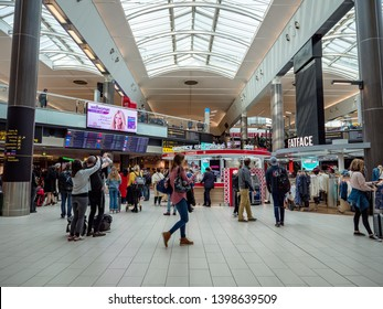 Gatwick Airport, UK - APRIL 15, 2019: London Gatwick Aiport interior lobby of shops, restaurants and passengers