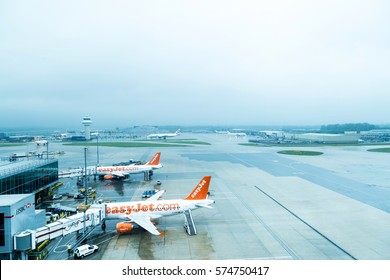 Gatwick, UK - May 14: View from the terminal to the airfield and airplanes Easyjet in wet weather- London Gatwick, UK on May 14, 2015