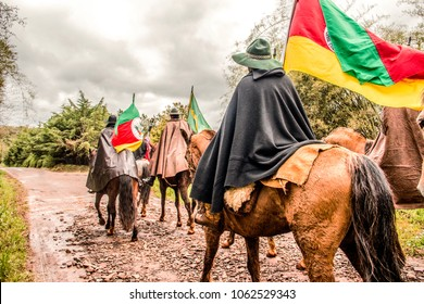 Gauchos riding and carrying the Creole flame to remember the victory in the war of rags. Tradition of the south of Brazil, RS.