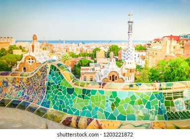 Gaudi bench and cityscape of Barcelona from park Guell, famous view of Barcelona, Spain, toned