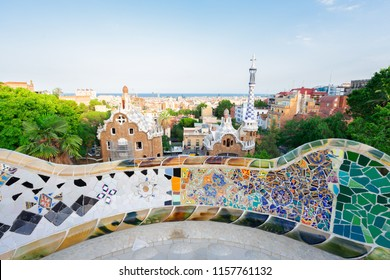 Gaudi mosaic bench detail and skyline of Barcelona from park Guell at sunset, Catalonia Spain