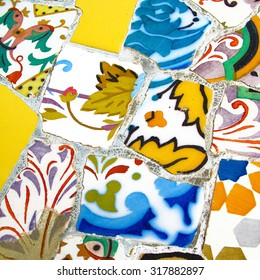 Gaudi mosaic in the Guell Park. Multicolored tiles with geometric and floral pattern, background. Photography.