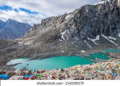 The Gauri Kund mountain lake during the ritual kora (yatra) around sacred Mount Kailash. Ngari scenery in West Tibet. Sacred place for Buddha pupils. Place of prayer, calm and meditation.