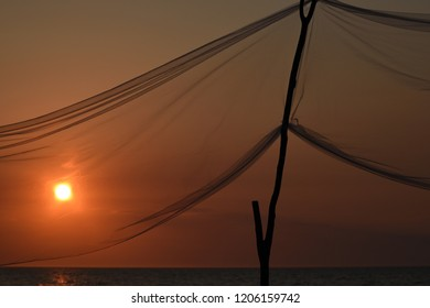 Gauze net in front of sunset on the beach
