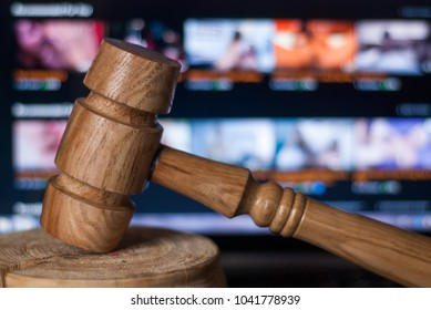 The gavel against the background of the laptop, illegal website with adult content, a court case in the manufacture and distribution of pornographic materials