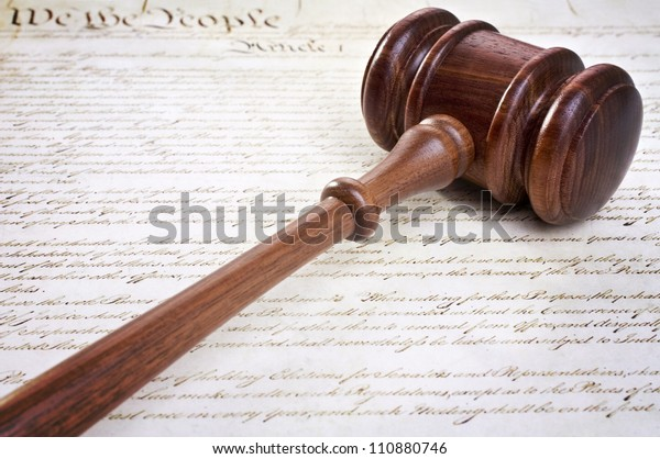 Gavel and American constitution. Concept of American justice.