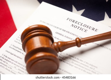 Gavel, American Flag and Foreclosure Notice with Selective Focus.