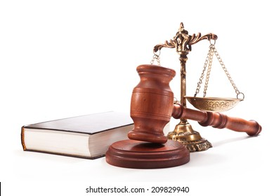 Gavel, book, antique bronze scales on a white background