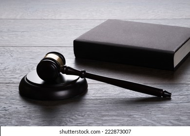 Gavel and book on the table in legal concept