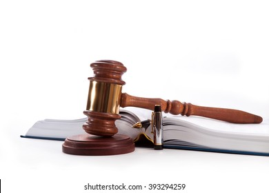 Gavel, book and pen on a white background