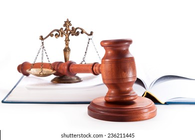 Gavel, book and scales on a white background
