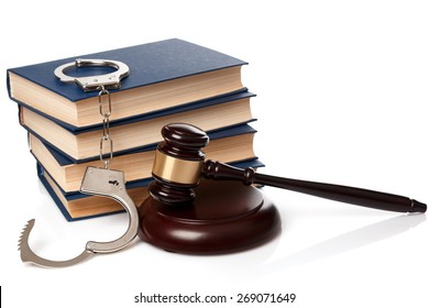 Gavel, books and handcuffs on white background
