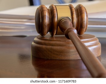 A Gavel by a Stack of Folders