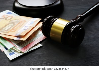 Gavel and euro banknotes. Bail bond or penalty in EU.