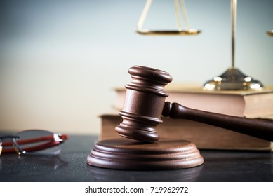 Gavel and Glasses on the book