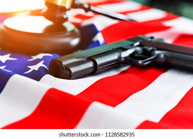 Gavel with gun over USA flag.