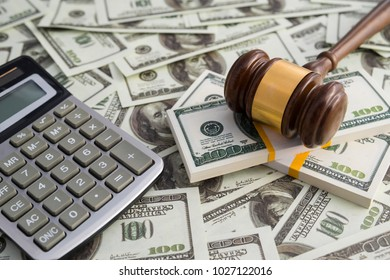 Gavel hammer judge money dollar calculator. financial concept, bribe, corruption. Business, court, law. Arrival and punishment