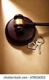 gavel hammer and key ring with house shape